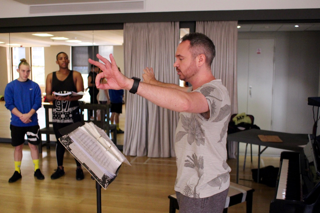Musical director Garth Tavares, with Devin Butterworth and Nathan Muller, rehearse for THE PRODUCERS